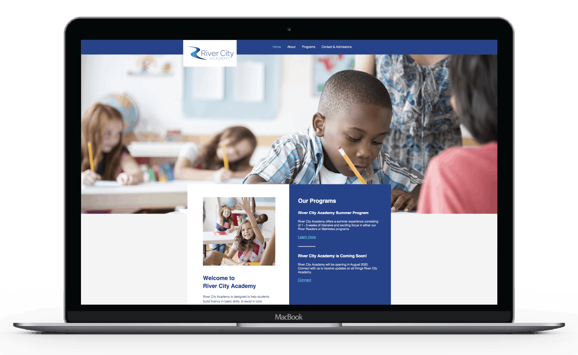 Client Project: River City Academy's website in a laptop view.